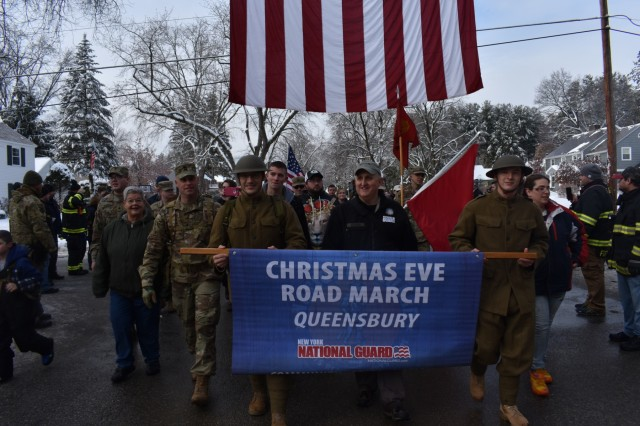N.Y. Army National Guard Soldiers and civilians march through Glens Fall, N.Y., Dec. 24, 2017. Soldiers and families of service members participated in Sgt. First Class (retired) Arthur Coon's Christmas Eve Road March to honor men and women currently deployed, who cannot celebrate the holidays with their families.