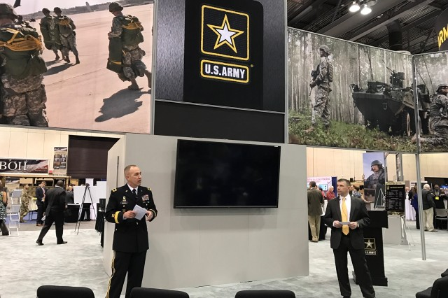 Brig. Gen. Karl Gingrich (left), PEO C3T's assistant program executive officer, and Larry Muzzelo, CECOM's executive deputy to the commanding general, discuss the Home Station Training Initiative during an AUSA Warriors Corner in Huntsville, Alabama, March 13, 2017.