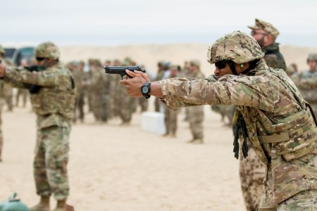 CAMP BUEHRING, Kuwait (Nov. 26, 2017) --  A Soldier takes aim with his 9mm pistol during the final event for the German Armed Forces Proficiency Badge. The pistol range tested participants' marksmanship abilities.