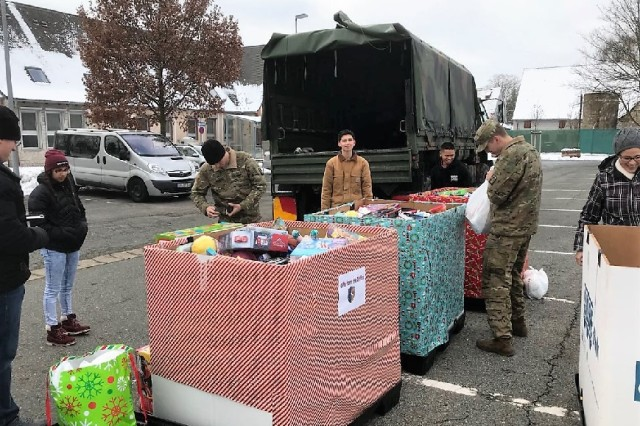 Soldiers of the 12th Combat Aviation Brigade deliver toys to German children.
