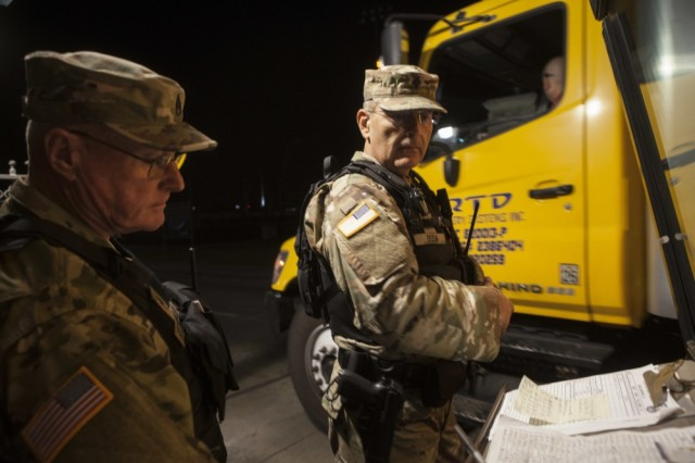 California State Military Reserve Staff Sgt. James Fitzgerald, left, and California State Military Reserve Spc. Juan Ossa, right, both with the Installation Support Command, finish logging delivering supplies to a wildfire response staging area at Joint Forces Training Base Los Alamitos, Calif., Dec. 11, 2017. The pair were put on emergency state active duty to augment the base's security forces as the base became a hub for 24/7 operations by the California National Guard and other agencies responding to multiple wildfires burning in Southern California.