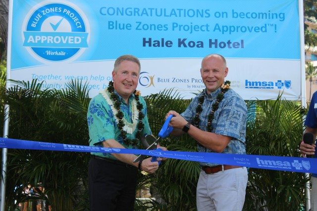 Hale Koa Hotel General Manager Richard LeBrun (left) with HMSA Sharecare Vice President Craig Petty cut ribbon celebrating the Hotel's achievement as the first hotel in the State to be an Approved Blue Zone worksite.