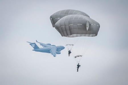 Paratroopers conduct airborne operations at Sicily Drop Zone during the 20th Annual Randy Oler Memorial Operation Toy Drop, Dec. 2, 2017. Operation Toy Drop, hosted by the U.S. Army Civil Affairs & Psychological Operations Command (Airborne), is the largest combined airborne operation conducted worldwide. The event and allows Soldiers the opportunity to train on their military occupational specialty, maintain their airborne readiness, and give back to the local community.