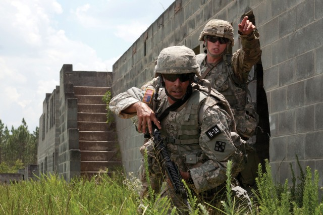 Sgt. Luciano Batista, left, and Sgt. Michael Hughes react to a simulated attack at the 2017 U.S. Army Reserve Best Warrior Competition at Fort Bragg, North Carolina, in June. Several Army working groups are looking at ways to field better sensing technologies that will help Soldiers react faster and more accurately.