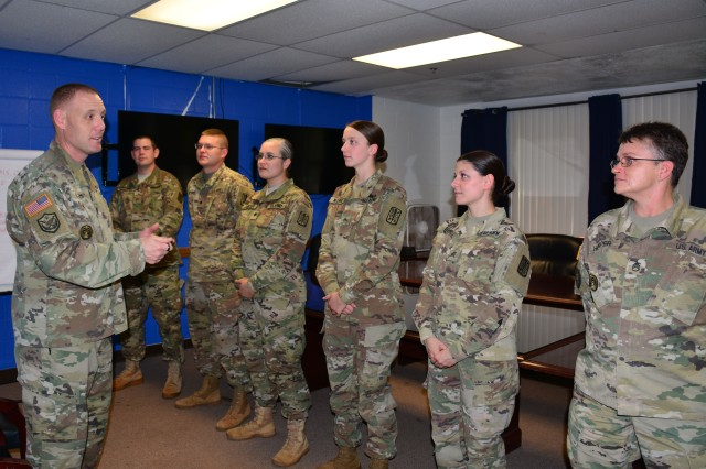 Command Sgt. Maj. Eric M. Schmitz, U.S. Army Intelligence and Security Command's senior enlisted noncommissioned officer, speaks with a group of Soldiers during his visit to the 500th Military Intelligence Brigade-Theater Headquarters, Schofield Barracks, Hawaii, Jan. 03.