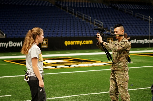 Cadet Dillon To, a native of Des Moines, Iowa, interviews Breanna Motsenbocker during the 2018 U.S. Army All-American Bowl, Alamodome in San Antonio, Texas, Jan. 4, 2018. As part of the Army's commitment to America's youth, the AAB brings former All-Americans to mentor current students throughout the week.