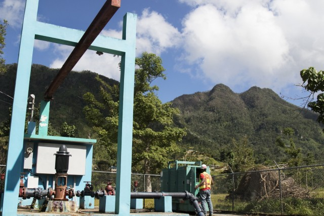 Shelby Deal, a quality assurance specialist with the U.S. Army Corps of Engineers' temporary emergency power mission in Puerto Rico, inspects a temporary emergency generator at a water pumping station near Jayuya, Puerto Rico Jan. 4.