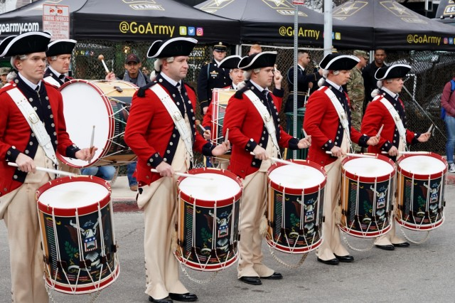 Members of the U.S. Army Old Guard Fife and Drum Corps demonstrate their craft at the GoArmy Experience Zone outside of the Alamodome in San Antonio, Texas, during the 2018 U.S. Army All-American Bowl Week, Jan. 5, 2018. The Army Experience Zone demonstrates the Army's commitment to America's youth by showcasing different aspects in Army life.