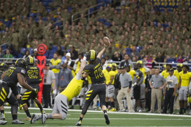 Trevor Lawrence, an athlete from Cartersville High School in Cartersville Ga., throws a pass during the U.S. Army All-American Bowl Jan. 6, 2018, in San Antonio, Texas. The All-American Bowl is the nation's premier high school football game, serving as the preeminent launching pad for America's future college and National Football League stars. (U.S. Army photo by Sgt. Ian Valley, 345th Public Affairs Detachment/Released)