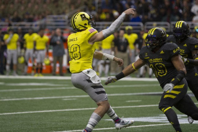 J.T. Daniels, an athlete from Mater Dei High School in Santa Ana, Calif., throws a pass during the U.S. Army All-American Bowl Jan. 6, 2018, in San Antonio, Texas. The All-American Bowl is the nation's premier high school football game, serving as the preeminent launching pad for America's future college and National Football League stars. (U.S. Army photo by Sgt. Ian Valley, 345th Public Affairs Detachment/Released)