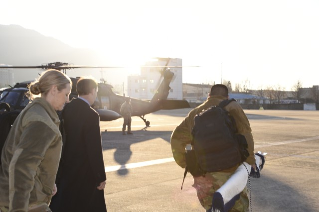 William J. Gillis and Col. Joy Curriera reach to the Camp Walker heliport to leave Area IV after a day visit to USAG Daegu.