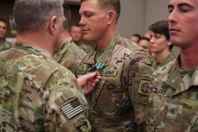 Gen. Mark Milley, chief of staff of the Army, pins an Army Commendation Medal with V device on Sgt. Mark Andrisek at Bagram Air Field, Afghanistan, on Tuesday, Dec. 19, 2017. Andrisek, along with Sgt. Joshua Sears, right, took quick action that saved American lives following a suicide car bombing on their route-clearing platoon convoy on Nov. 13, 2017.