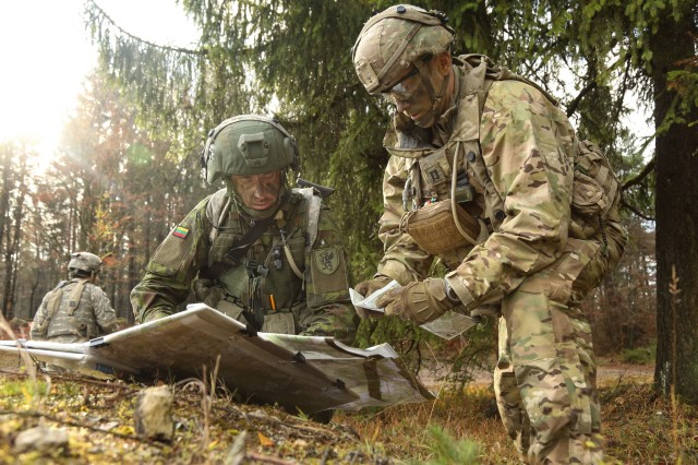 U.S. Army Capt. Bryan Von Dohlen, right, of the 1st Squadron, 2nd Cavalry Regiment and Lithuanian army Capt. Ilgaydas Vidas of the Lithuanian Griffin Brigade discuss mission details while conducting battle circulations during exercise Allied Spirit VII at the U.S. Army's Joint Multinational Readiness Center in Hohenfels, Germany, Nov. 13, 2017.