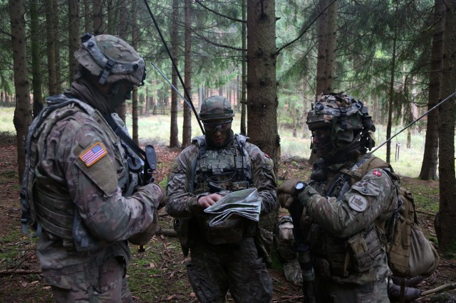 A U.S. Soldier, left, of the 82nd Engineer Battalion and Danish soldiers of Alpha Company, 1st Battalion, Royal Guard, discuss timelines during exercise Allied Spirit VII at the U.S. Army's Joint Multinational Readiness Center in Hohenfels, Germany, Nov. 7, 2017.