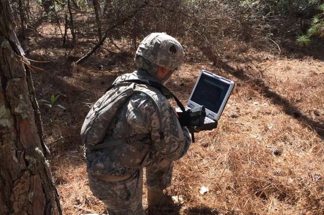 2nd Lt. Ian Reynoso uses a field computer to probe for a targeted wireless network signal during a field training exercise at Fort Gordon, Georgia, March 1, 2017.