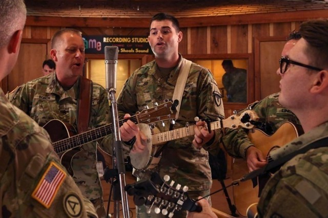 During a recording session at Fame Studios in Muscle Shoals, Ala., Soldiers from the Army Materiel Command Band and the Army Field Band's Six String Soldiers join forces. The AMC Band collaborated with many musicians to create a farewell album with the authentic Muscle Shoals sound. U.S. Army Photo by Sgt. David Dorfman