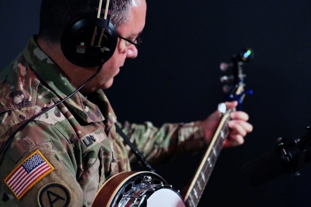 Sgt. 1st Class Thomas Lindsey from the Army Field Band's Six-String Soldiers prepares for a recording session at Fame Studios in Muscle Shoals on Sept. 20. U.S. Army Photo by Sgt. David Dorfman.