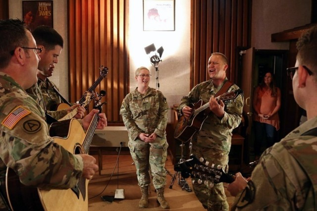 "Soldiers from the Army Materiel Command Band and the Army Field Band sing ""Country Roads"" during a recording session at Fame Studios in Muscle Shoals on Sept. 20. U.S. Army Photo by Sgt. David Dorfman"