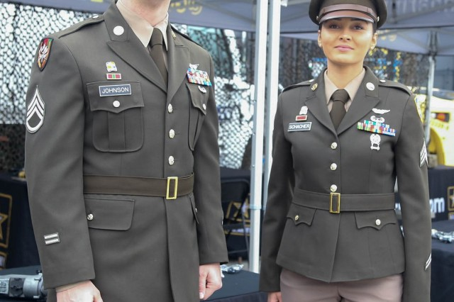"Staff Sgt. Aaron Johnson and Sgt. April Schacher from Fort Belvoir model proposed ""pink and brown"" dress uniforms currently under consideration by Army officials."
