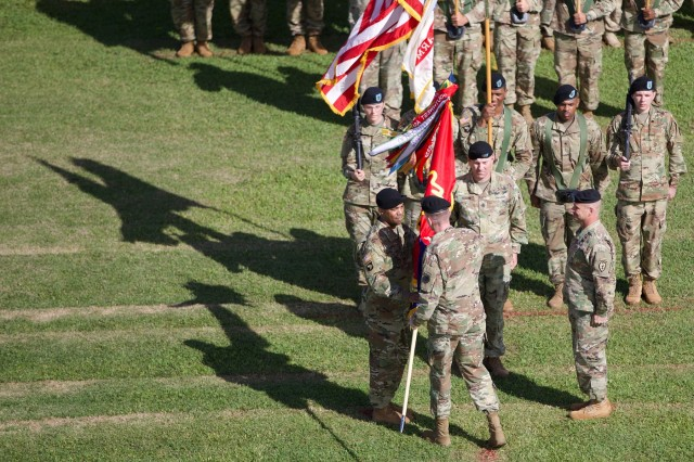 Lt. Gen. Gary Volesky, I Corps commanding general, passes the 25th Infantry Division colors to the new Tropic Lightning commander, Maj. Gen. Ron Clark at Weyand Field, Schofield Barracks, Jan. 4. (U.S. Army photo by Sgt. Ian Ives, 25th Sustainment Brigade Public Affairs, 25th Infantry Division)