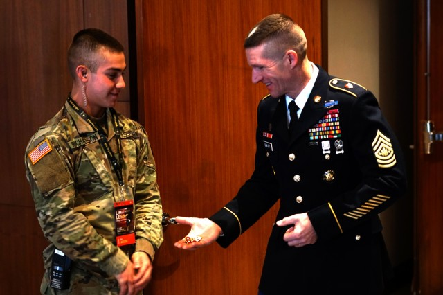 Sgt. Maj. of the Army, Daniel Dailey, coins a Soldier for his excellence before a leaders panel on matters affecting the Army at the Grand Hyatt Hotel in San Antonio, Texas, as part of the 2018 U.S. Army All-American Bowl week Jan. 6, 2018. The panel covered what it takes to be a U.S. Army Soldier, where the Army is headed today to meet the future needs of the Nation, and what remains the same about the Army.