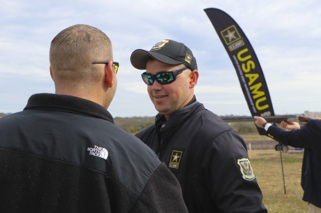 Staff Sgt. Derek Haldeman, a Soldier with the U.S. Army Marksmanship Unit's Shotgun Team, provides instruction on how to properly shoot and handle a shotgun at one of the U.S. Army All-American Bowl events Jan. 4, 2018. The world-class competitive-shooting Soldiers allowed guests the opportunity to shoot the shotguns and performed a trick-shoot demonstration. (U.S. Army Reserve photo by Spc. Tynisha L. Daniel/Released)