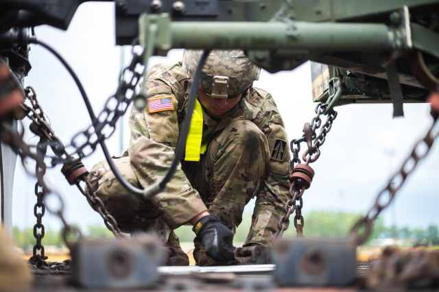 An Indiana National Guardsman fastens and inspects equipment being loaded onto a railcar at Camp Atterbury, Indiana on July 6, 2017. Army Materiel Command's Gen. Gus Perna told Army leaders at a conference on Jan. 5, 2018 in Little Rock, Arkansas, to focus on logistics as a means of readiness.