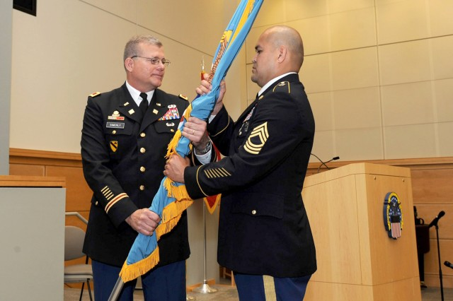 Army Col. Mark Simerly, DLA Troop Support incoming commander, passes the DLA flag to Army Master Sgt. Jose Moraga, DLA Troop Support senior enlisted service member, during a change of command ceremony July 11 in Philadelphia. Simerly was previously the director of capabilities, development and integration with the Combined Arms Support Command at Fort Lee, Virginia.