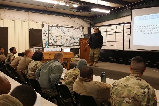 Staff Sgt. Ronnie Talsma provides classroom instruction on the azimuth for Soldiers from the 900th Contracting Battalion during warrior task skills training Dec. 13 at Fort Bragg, North Carolina. Talsma is an operations NCO with the 82nd Airborne Division's Small Unit Ranger Tactics cadre.