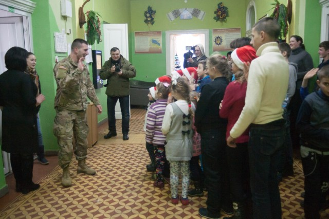 Krakovets, Ukraine - Soldiers from the 27th Infantry Brigade Combat Team deployed to Ukraine spent the day visiting a Ukrainian orphanage here Dec. 27. During the visit, Soldiers brought games and toys to give to the children, and spent a few hours interacting and playing with them.