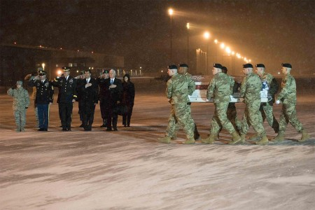 Soldiers of the 3rd U.S. Infantry Regiment (The Old Guard) transfers the remains of Sgt. 1st Class Mihail Golin at Dover Air Force Base, Del., Jan. 3, 2018. Golin, an 18B Special Forces weapons sergeant, assigned to 2nd Battalion, 10th Special Forces Group (Airborne), died Jan. 1, 2018, as a result of wounds he sustained while engaged in combat operations in Nangarhar Province, Afghanistan.