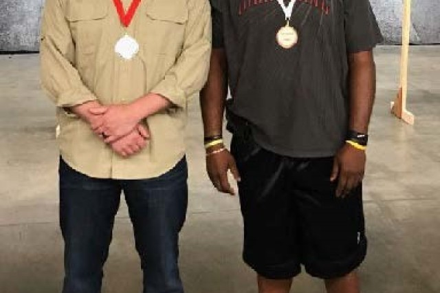 Sgt. Aaron Averre (left) and Sgt. 1st Class Sean Miller (right) display their medals at the Air Gun Series by USA Veterans Outreach Program event in Fayetteville, N.C.