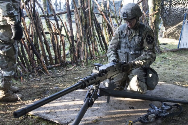 A Soldier with 1-2 Stryker Brigade Combat Team practices correcting a malfunction on an M2 Machine Gun before testing for Expert Infantryman Badge weapons lane Dec. 12, 2017, at Joint Base Lewis-McChord, Washington. The number of candidates was 324 when testing began Dec. 11, but only 73 earned their badge on Dec. 15.
