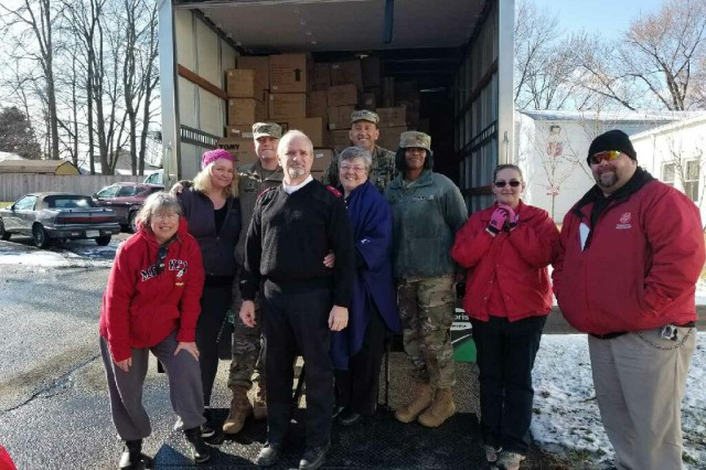 Members of the Havre de Grace Salvation Army and the Headquarters and Headquarters Companies of the U.S. Army Test and Evaluation Command and Aberdeen Proving Ground Garrison, work together to relocate toys they have collected for their annual Angel Tree Program, Dec. 14.
