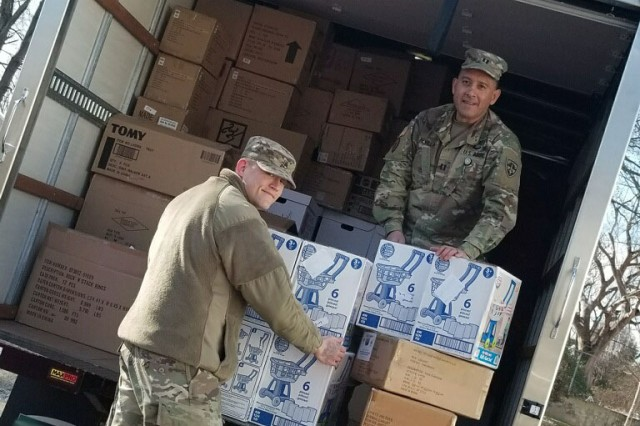 Two of the U.S. Army Test and Evaluation Command's Headquarters and Headquarters Company Soldiers, Staff Sgt. Justin Johnson (left) and Cpt. Luis Revilla (right) help out the Havre de Grace Salvation Army in the relocation of their toys they have collected for their annual Angel Tree Program.