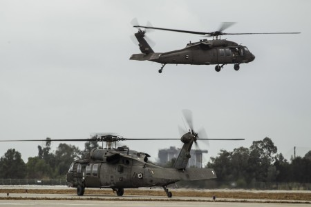 A pair of California Army National Guard UH-60 Black Hawk helicopters take off from Los Alamitos Army Airfield, Calif., Jan. 9, 2018. The helicopters, along with their crews and rescue equipment, were activated from the airfield's flight facility to assist civil authorities with response to storm-driven mudslides in areas burned by recent wildfires in Southern California. Eight California National Guard helicopters were activated throughout the state.
