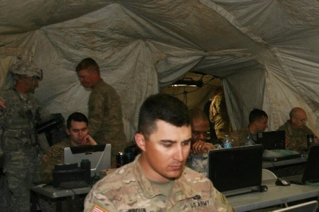 A Soldier from the 1st Armored Brigade Combat Team, 3rd Infantry Division works on his laptop in the brigade main command post during the Secure Wi-Fi pilot at the National Training Center, at Fort Irwin, California, in April 2017.
