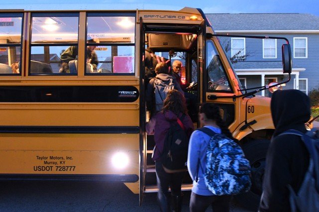 FORT KNOX, Kentucky -- Doris Davis watches as Fort Knox children load into her bus at the start of a school day. She runs several routes each day.