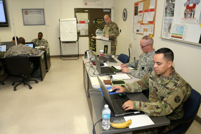 Instructor Sgt. 1st Class Jason Boyles (standing) with Regional Training Site-Maintenance teaches a class for the Career Management Field 91/94 Ordnance Senior Leader Course on Dec. 13, 2017, at Fort McCoy, Wis. The course is resident training delivered via small group instruction with an emphasis on Army ordnance leadership logistics management. The course primarily supports training in the Army's 91 and 94 military occupational specialties and includes 80 hours of training. (U.S. Army Photo by Scott T. Sturkol, Public Affairs Office, Fort McCoy, Wis.)