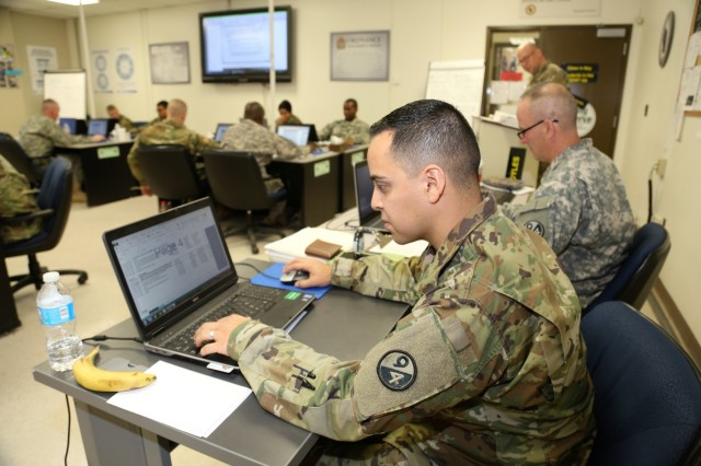 Sgt. 1st Class Jorge Gonzalez and Sgt. 1st Class Timothy Bruno, both instructors supporting Regional Training Site-Maintenance, prepare materials for a class for the Career Management Field 91/94 Ordnance Senior Leader Course on Dec. 13, 2017, at Fort McCoy, Wis. The course is resident training delivered via small group instruction with an emphasis on Army ordnance leadership logistics management. The course primarily supports training in the Army's 91 and 94 military occupational specialties and includes 80 hours of training. (U.S. Army Photo by Scott T. Sturkol, Public Affairs Office, Fort McCoy, Wis.)