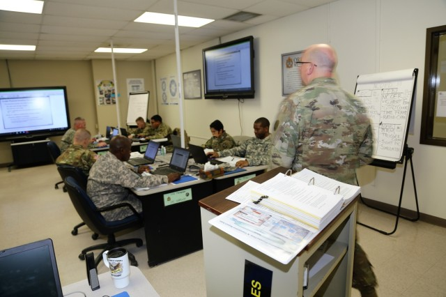 Instructor Sgt. 1st Class Jason Boyles with Regional Training Site-Maintenance teaches a class for the Career Management Field 91/94 Ordnance Senior Leader Course on Dec. 13, 2017, at Fort McCoy, Wis. The course is resident training delivered via small group instruction with an emphasis on Army ordnance leadership logistics management. The course primarily supports training in the Army's 91 and 94 military occupational specialties and includes 80 hours of training. (U.S. Army Photo by Scott T. Sturkol, Public Affairs Office, Fort McCoy, Wis.)
