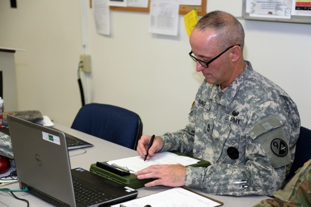 Sgt. 1st Class Timothy Bruno, an instructor supporting Regional Training Site-Maintenance, prepares materials for a class for the Career Management Field 91/94 Ordnance Senior Leader Course on Dec. 13, 2017, at Fort McCoy, Wis. The course is resident training delivered via small group instruction with an emphasis on Army ordnance leadership logistics management. The course primarily supports training in the Army's 91 and 94 military occupational specialties and includes 80 hours of training. (U.S. Army Photo by Scott T. Sturkol, Public Affairs Office, Fort McCoy, Wis.)