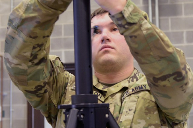Indiana National Guard Spc. Nick Gleason, of Fort Wayne and a 738th Signal Company signal support specialist, erects an antenna for a state-active duty exercise, Friday, Jan. 5, 2018 in Franklin, Ind. The signal company soldiers worked alongside local, first-response organizations to test and familiarize themselves with a communication system designed to work across myriad frequencies.