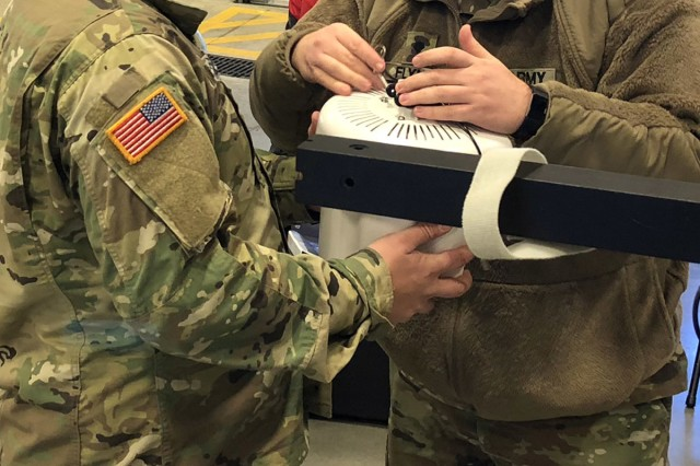 Indiana National Guard Spc. Nick Gleason and Spc. Evan Flynn, attach a wireless access point to an antenna for a state-active duty exercise, Friday, Jan. 5, 2018 in Franklin, Ind. The signal company soldiers worked alongside local, first-response organizations to test and familiarize themselves with a communication system designed to work across myriad frequencies.