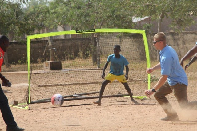 Spc. Ryan Worwood of Task Force Darby and 1st Battalion, 87th Infantry Regiment, 1st Brigade Combat Team, 10th Mountain Division, plays soccer with the boys of the Saare Jabbama youth rehabilitation center, Dec. 23, 2017 in Garoua, Cameroon.