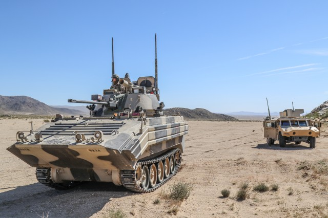 Vehicles from 1st Squadron, 11th Armored Cavalry Regiment hold their positions during movement to engage elements of the 1st Armored Brigade Combat Team, 3rd Infantry Division, in the National Training Center, April 2, 2017.  During the training rotation, Secure Wi-Fi enabled fast reliable mission command and network communications in the brigade main command post to enhance the situational awareness of the entire force.