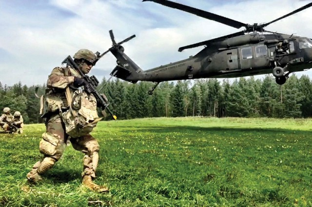 "Infantrymen with 3rd Armored Brigade Combat Team (""Iron Brigade""), 4th Infantry Division (3-4 ABCT), conduct an air assault in August with 3rd General Support Aviation Battalion, 10th Combat Aviation Brigade during the U.S. Army Europe Combined Resolve IX exercise at Grafenwoehr Training Area, Germany. Army S&T is pursuing aircraft survivability technologies across a spectrum of technologies and areas of expertise."