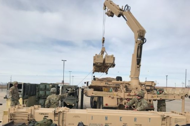 Soldiers from B Battery, 3rd Battalion, 2nd Air Defense Artillery, conduct missile reload training using the guided missile transporter at Fort Sill in December 2017.