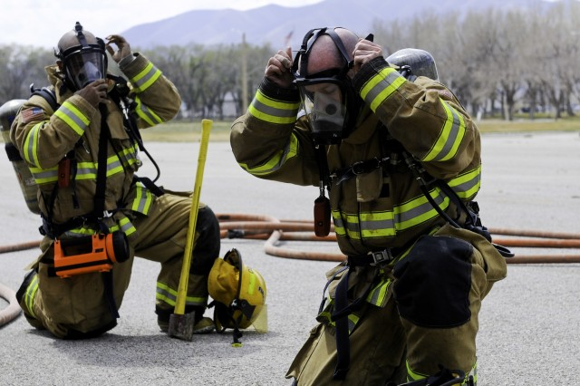 Soldier-firefighters of the 63rd Ordnance Co. prepare to fight fires in Yakima, Washington.