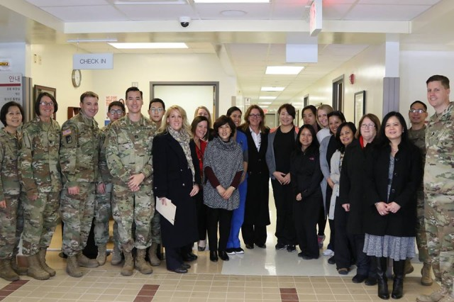 Mrs. Leah Esper, spouse of Secretary of the Army Mark T. Esper, poses for a group photo with service members, their Families, and civilian employees at the troop medical center at U.S. Army Garrison Humphreys, Jan. 9, 2018.